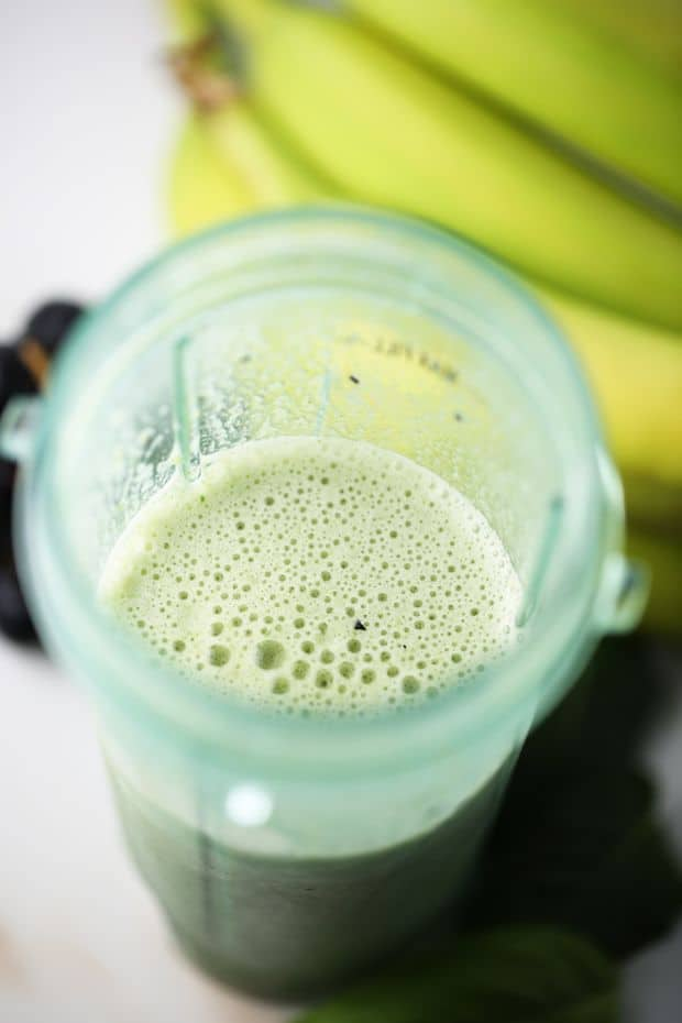 healthy spinach smoothie done blending