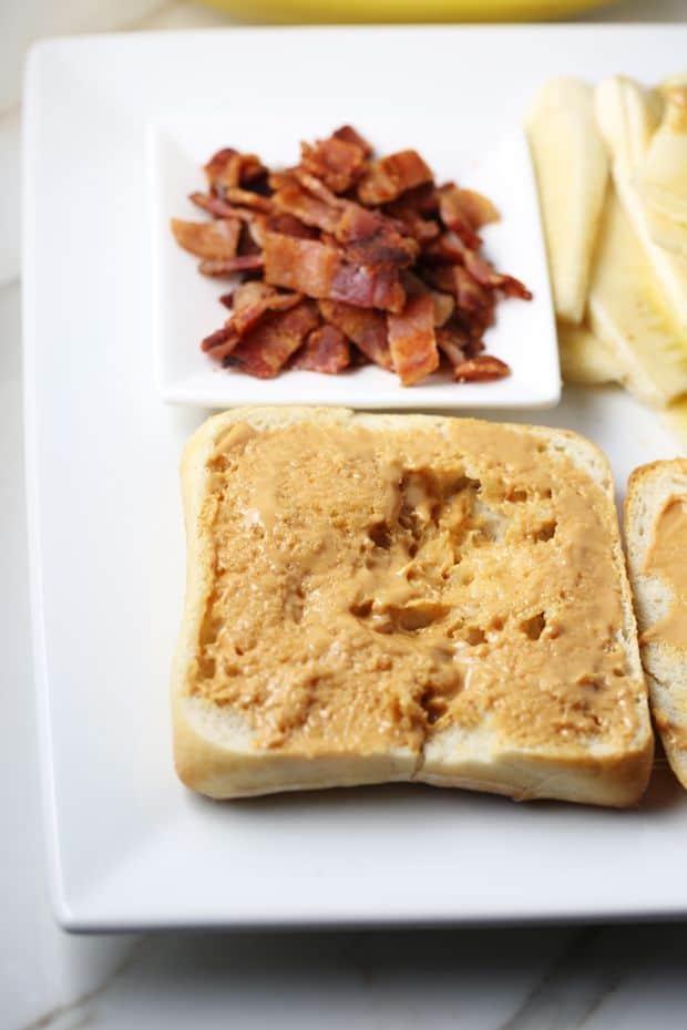 Peanut Butter Banana Bacon Sandwich spread the butter