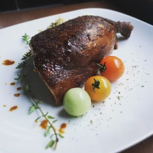Smoked chicken with herbs and cherry tomatoes