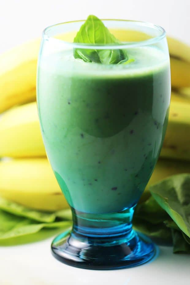 Healthy spinach banana mint smoothie basil garnish