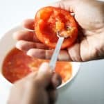Stuffed tomatoes scooping out