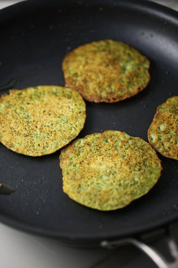 kale potato pancakes on the frying pan