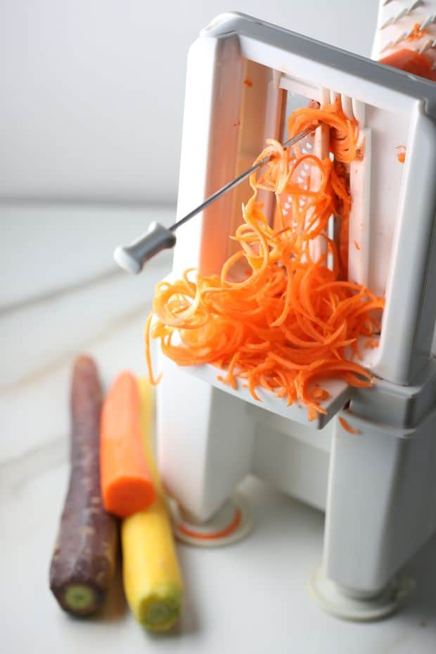 Healthy Multi colored Carrot salad spiralizer in action